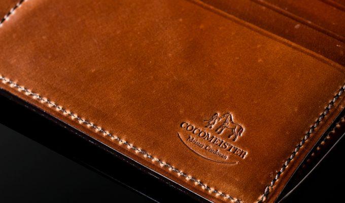 シェルコードバンの財布のロゴ