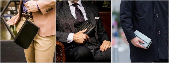 大きい長財布、やや大きい長財布、微妙に大きい長財布を持つ男性