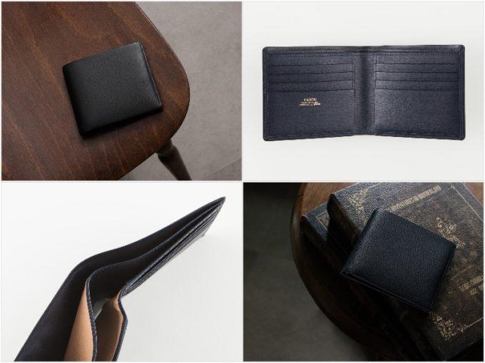 テーブルの上に置いてあるキップ水シボ二つ折り財布の外装と内装収納ポケット